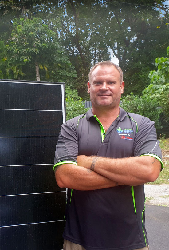 Jason, Solar NQ Director, standing next to quality solar panel product.