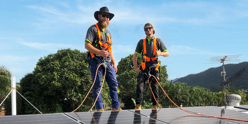 Solar NQ installation experts standing on roof with energy system setup