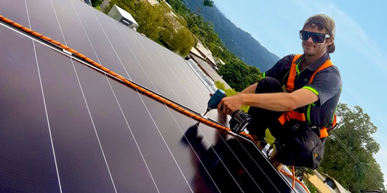 Solar panels getting health and safety checked by Solar NQ team member